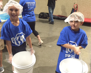 Kids helping out at Stop Hunger Now event